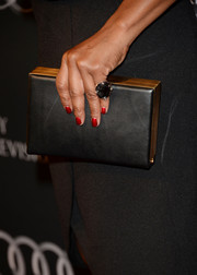 Sufe Bradshaw carried a simple yet elegant black and gold box clutch when she attended the BAFTA LA TV Tea.