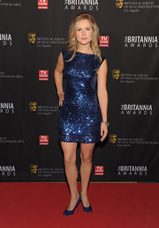 Amelia Jackson sparkled on the red carpet in a sequined dress. She paired her look with vibrant blue pumps.
