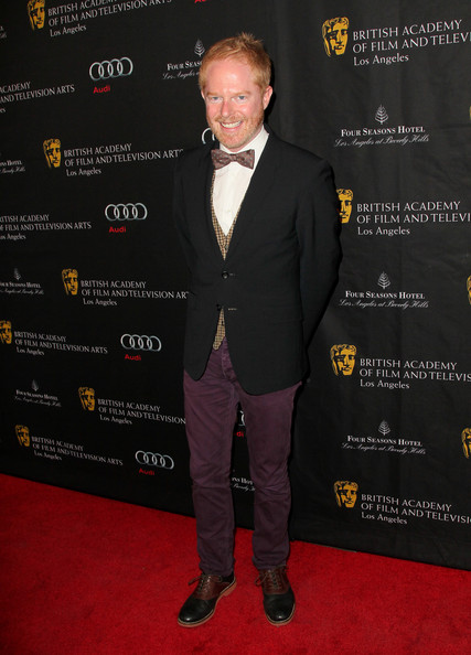 Eggplant skinny pants are a nice change from the traditional suit! Jesse Tyler Ferguson's bold choice was a good one.
