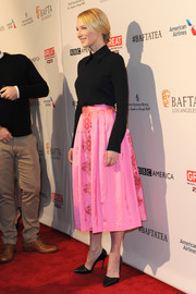 Cate Blanchett was sophisticated in a turtleneck black top and full bright pink skirt with floral detailing.