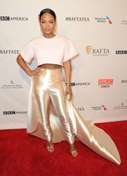 Christina Milian brought the drama in a pastel pink crop top and high-waisted satin gold pants with a flowing train.
