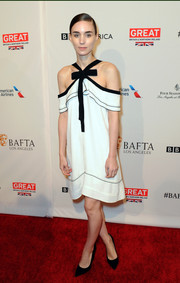 Rooney Mara donned a monohchromatic black and white draped dress with bow detailing that she matched with black pumps.