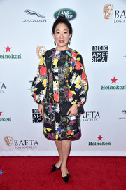 Sandra Oh looked vibrant in a patchwork print dress by Duro Olowu at the BAFTA Los Angeles + BBC America TV Tea Party.
