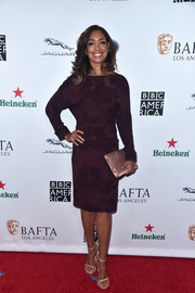 Gina Torres paired her dress with a blush satin clutch.