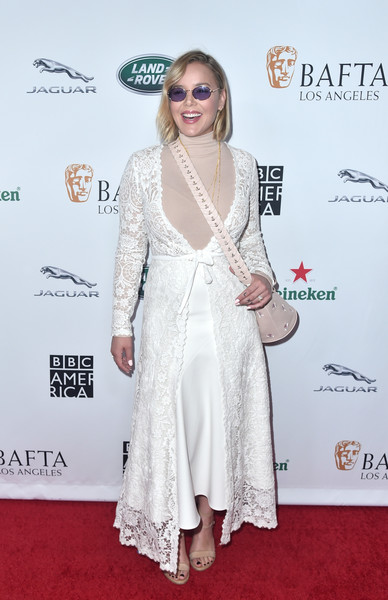 Abbie Cornish layered a white Tadashi Shoji lace duster over a matching skirt and a nude turtleneck for the BAFTA Los Angeles + BBC America TV Tea Party.