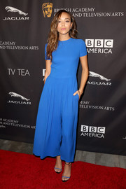 Ashley Madekwe looked cool and stylish in a short-sleeve, wide-leg blue jumpsuit by Christian Dior at the BAFTA Los Angeles TV tea party.