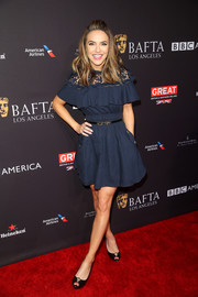 Chrishell Stause looked adorable in a navy mini dress with a lace neckline at the BAFTA Los Angeles tea party.
