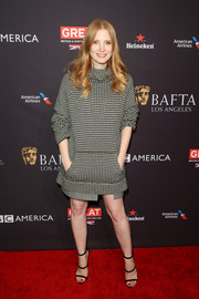 Jessica Chastain showed off her winter style with this funnel-neck houndstooth dress by Ralph Lauren at the BAFTA Los Angeles Tea Party.