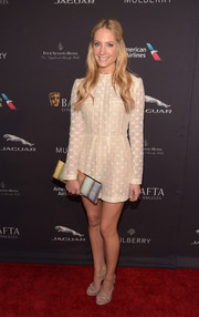 A multicolored Jimmy Choo clutch injected a lovely mix of pastels into Joanne Froggatt's neutral outfit.