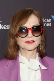 Isabelle Huppert accessorized with oversized ombre shades by Louis Vuitton for that extra cool factor.