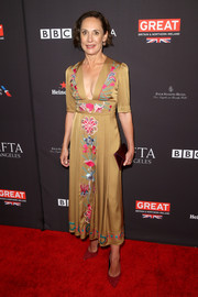 Laurie Metcalf looked effortlessly stylish in a deep-V, embroidered midi dress by Temperley London at the BAFTA Los Angeles Tea Party.