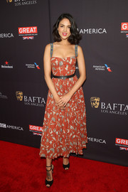 Eiza Gonzalez looked very girly in a red Dior print dress with contrast shoulder straps at the BAFTA Los Angeles Tea Party.