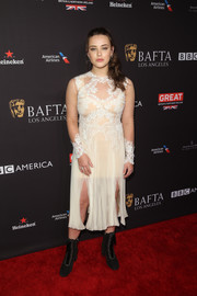 Katherine Langford attended the BAFTA Los Angeles Tea Party wearing a lace-accented cream cocktail dress by Valentino.