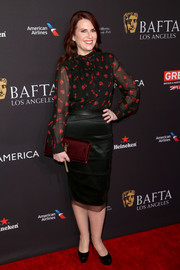 Megan Mullally paired her blouse with a black satin pencil skirt.