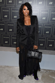 June Ambrose finished off her all-black look with a stylish fur purse by Tom Ford.