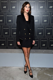 Alexa Chung cut a sharp figure in a double-breasted blazer by Balmain x H&M (which she wore as a dress) during the collaboration's launch.