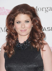 Debra Messing added a lot of volume to her fiery curled tresses for the BAM 150th Anniversary Gala.