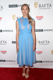 Yvonne Strahovski looked demure in a sky-blue pussybow dress at the BAFTA Los Angeles TV tea party.