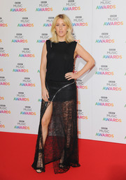 For a chicer, sexier finish, Ellie Goulding teamed her top with a sheer lace maxi skirt with a high front slit.