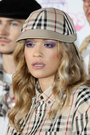 For her beauty look, Rita Ora went glam with a smoky application of lavender eyeshadow.