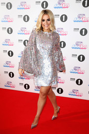 Tallia Storm kept the shine going with a pair of silver pumps.