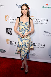 Lily Collins looked very girly in a Johanna Ortiz floral bustier top with bowed shoulder straps at the BBCA BAFTA Tea Party.