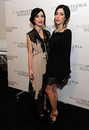 Lisa Origliasso opted for a lace trimmed wrap dress at the BCBG Max Aria fashion show.