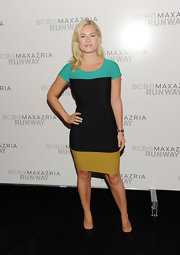Elisha Cuthbert showed off her enviable figure in a colorblock dress backstage at the BCBG Max Azria Spring 2012 fashion show.