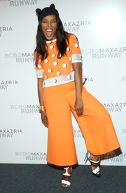 June Ambrose kept it youthful and funky at the BCBG Max Azria fashion show in an orange and white polka-dot top with mesh detailing.