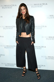 Sara Sampaio attended the BCBG Max Azria fashion show wearing a black leather jacket over a crop-top.