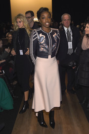 Estelle contrasted her tough-looking top with a delicate blush-colored skirt, also by BCBG Max Azria.