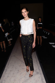 Hilary Rhoda finished off her trendy outit with a pair of metallic print pants.