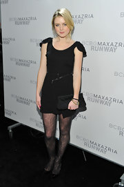Lorraine Nicholson added girly glamour to her look with a black satin clutch.