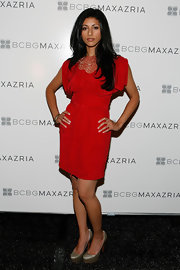 Reshma Shetty paired simple silver platform pumps with her red dress.