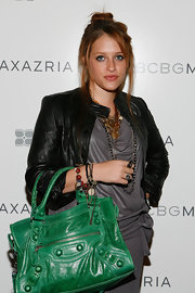 Carly added color with a green leather bag.
