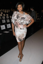 Taraji posed on the BCBG runway in a floral print off-the-shoulder knit dress.