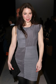 Lynn Collins added sparkle to her fitted lavender dress with a black sparkly clutch.
