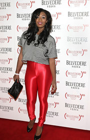 Toccara Jones matched her metallic skinnies with a thinly stripped crop tee.