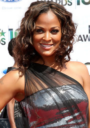 Laila Ali showed off her softly highlighted medium curls while walking the red carpet at the BET Awards.