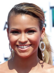 Cassie lit up the carpet with her honey blonde locks and diamond round earrings.