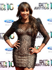 Vivica completed her beaded mini dress with a highlighted, wavy hairstyle and lash-sweeping bangs.