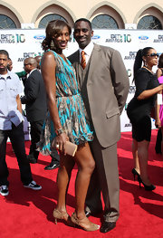 Lisa Leslie showed off a softer side in a printed cocktail dress which she paired with the perfect box clutch.