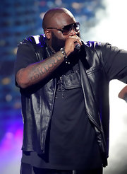 While preforming at the BET Awards. Rick Ross showed off his arm tattoo.