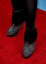 Kym Whitely added some sparkle to red carpet look with sparkle ankle booties with fringe.
