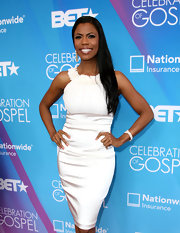Omarosa chose a simple and elegant white cocktail dress with a floral neckline for her look on the BET red carpet.