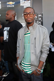 B.o.B paired his striped shirt with a gray track jacket.