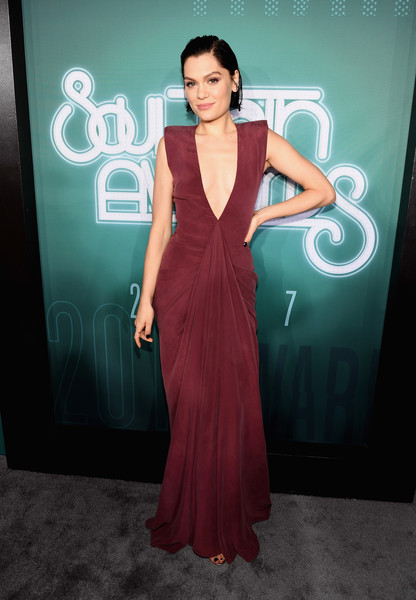 Jessie J went for sexy glamour in a plunging burgundy gown by Dilek Hanif Couture at the 2017 Soul Train Awards.
