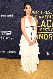 Alexandra Shipp went the flirty route in a plunging white halter gown with a multi-tiered skirt at the American Black Film Festival Honors.