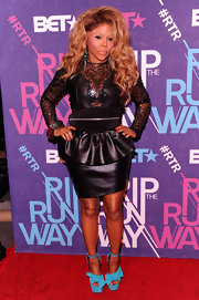 Lil Kim wore this unique leather dress to BET's Rip the Runway.