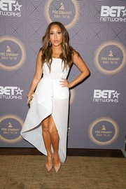 Adrienne Bailon showed some skin in a strapless white dress with a high-low hem during BET's pre-Grammy brunch.